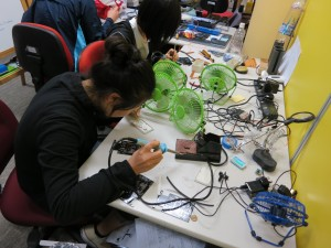 Figure 1. Students soldered the robotic car components together.