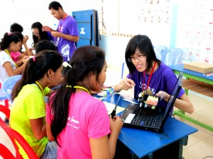 Figure 2. We taught the Cambodian teenagers how to program the robots.